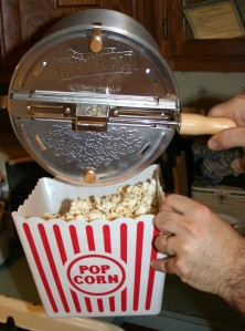 Popcorn into the big popcorn bowl