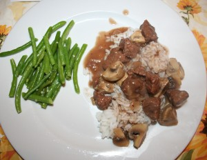 Beef Burgandy on a bed of rice with green beans