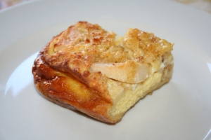 Slice of baked apple pancake