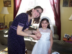 Giving Alexandra her special First Communion bracelet, a tradition we started with Caroline.