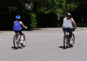 Bike riding is just one of the fun, free summer activities you can do with your kids!